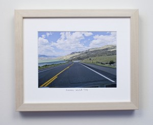 framed photograph, taken from car while driving across USA, with title handwritten on matt
